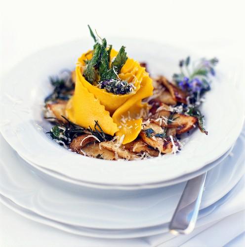 Saffron papardelle on fried cep mushrooms