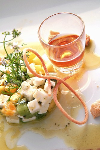 Fruit salad with goat's cheese, aperitif