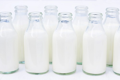 Small bottles of cream, opened
