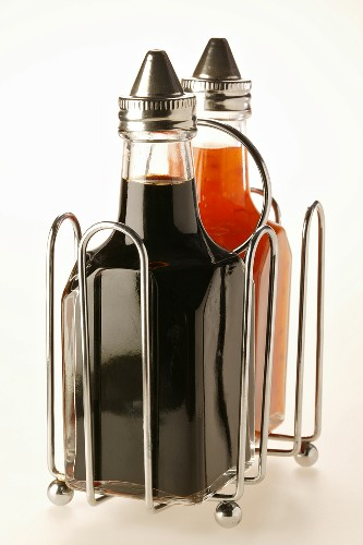 Chili sauce and soy sauce in small bottles