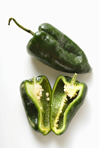 Green peppers (Poblano from Mexico), whole and halved