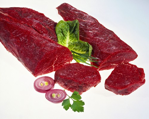 Two joints of beef, two slices of beef, salad
