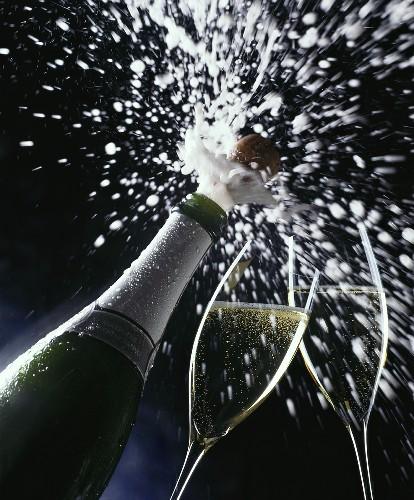 Cork flying out of sparkling wine bottle