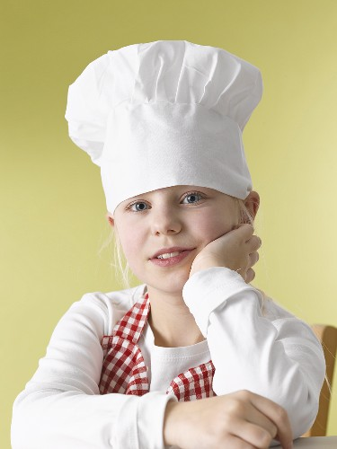 Girl in chef's hat and apron