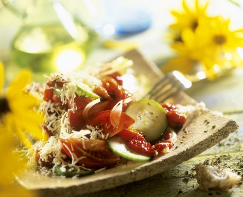 Tomato & cucumber salad with tomato sauce & grated cheese