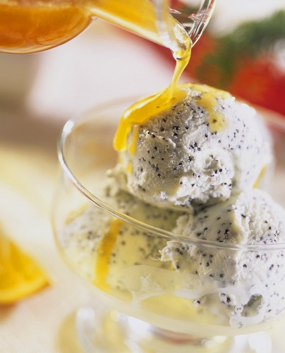 Vanilla and poppy seed ice cream with orange syrup