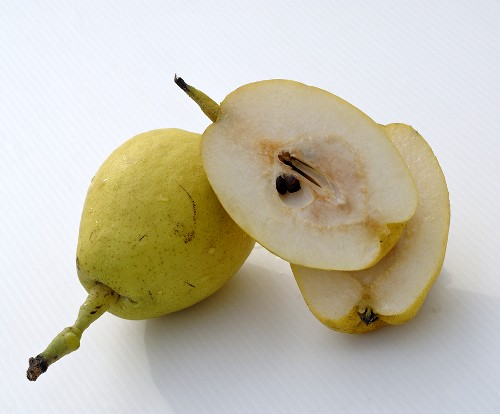 Whole and halved Nashi pears