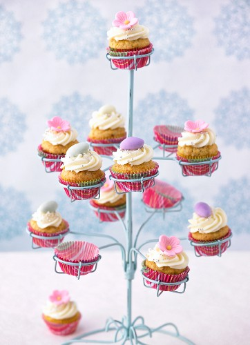 Carrot cupcakes with frosting in a cupcake holder