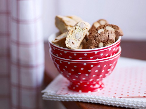 A bowl of chocolate almond biscuits and hazelnut biscuits