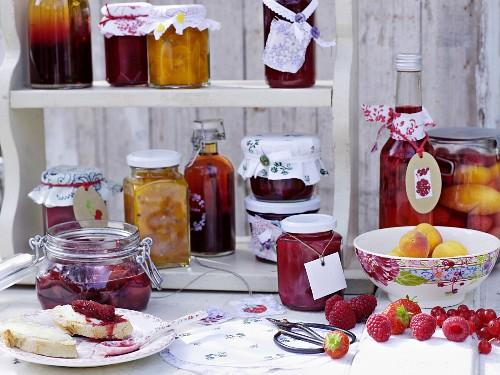 Preserved fruit and jars of jam on a shelf