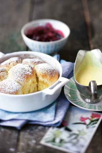 Buchteln (baked, sweet yeast dumplings) with vanilla sauce and stewed damsons (Austria)