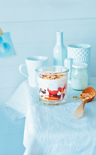 Fruit salad with yogurt in a glass