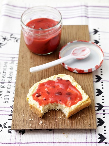 A slice of buttermilk bread spread with raspberry jam