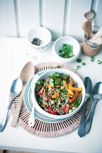 Fried minced meat and vegetables with buckwheat