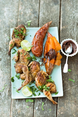 Halved quails, sweet potatoes and cocoa and chilli butter