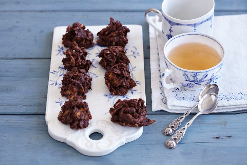 Chocolate crispy cakes with slivered almonds and cornflakes