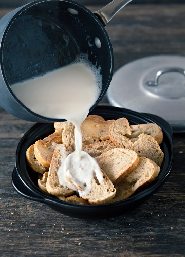 Napkin dumplings being made: white bread being soaked in milk