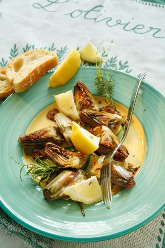 Roasted artichokes with thyme and rosemary
