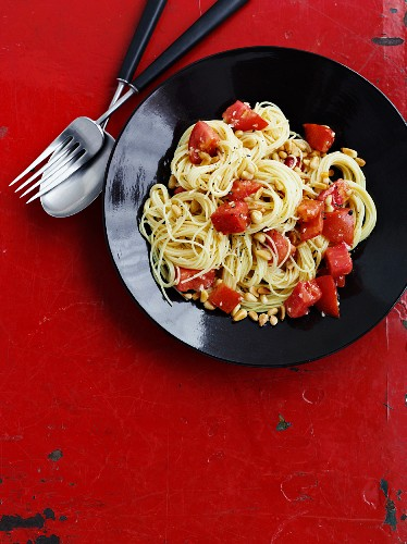 Capellini pasta with tomatoes, garlic and pine nuts