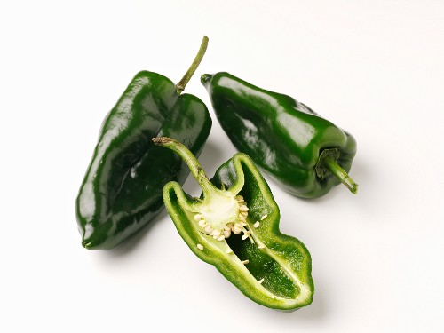 Poblano chilli peppers, whole and halved
