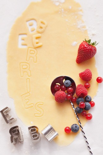 Shortcrust pastry with alphabet cutters and berries