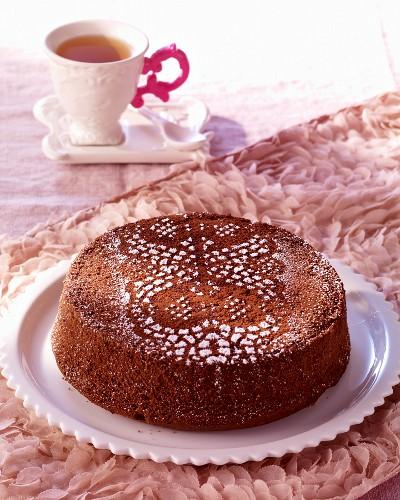 Celebratory chocolate cake dusted with icing sugar