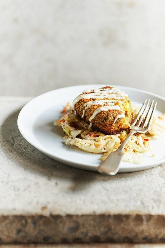 Crab Cake on a Bed of Spicy Slaw Topped with Garlic Aioli