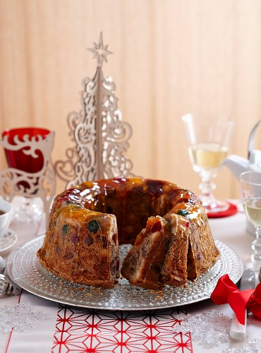 Festive fruit cake with candied fruits and caramel drizzle