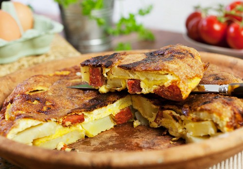 Spanish omelette with chorizo, one slice cut