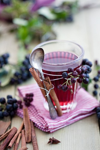 Aronia mulled wine with spices in decorated glass