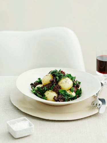 Steamed potatoes with blood sausage and barley
