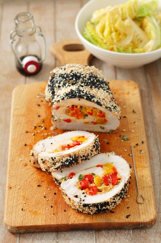 Rolled roast turkey stuffed with peppers