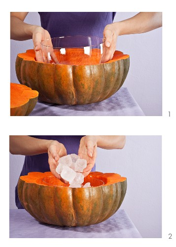 A hollowed-out pumpkin being turned into a bottle cooler