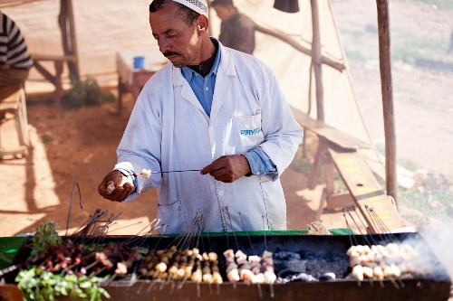 Barbecued kebabs at a market (North Africa)