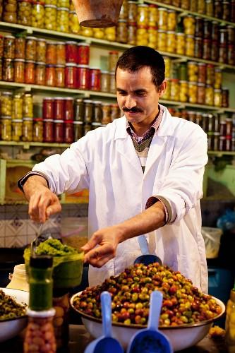 A shopkeeper in a delicatessen in North Africa