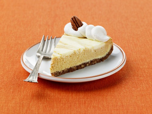 A Slice of Marbled Pumpkin Cheesecake with Gingersnap Cookie Crust