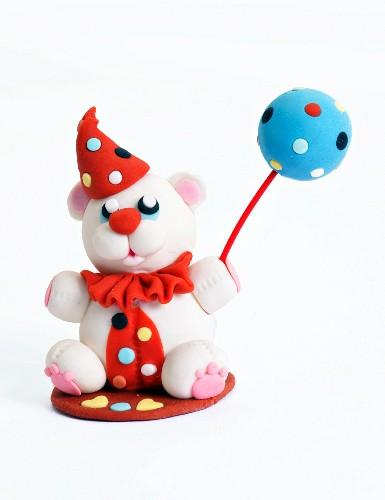 A fondant bear with a cake pop