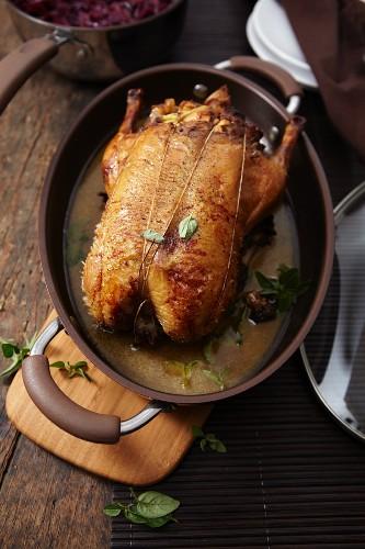 Roast duck in a stew pot