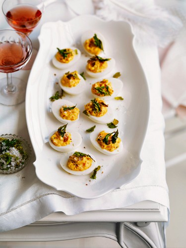Devilled eggs with celery and coriander salt