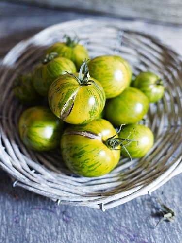 Green zebra tomatoes in a wicker basket