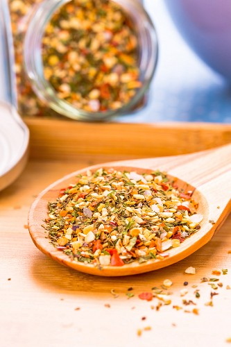 Bruschetta spice mix on a wooden spoon