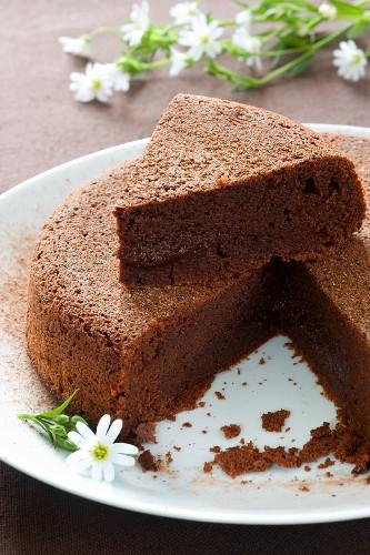 Chocolate cake with a piece cut