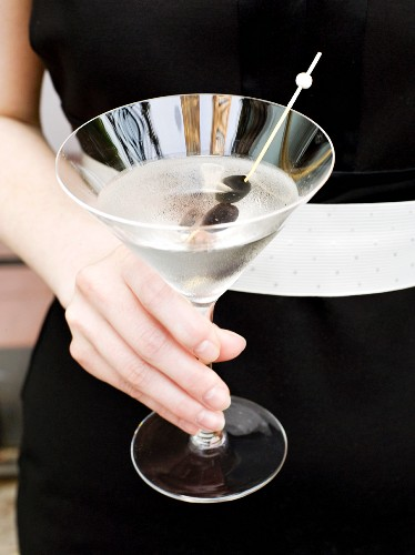 Woman in Formal Dress Holding a Martini