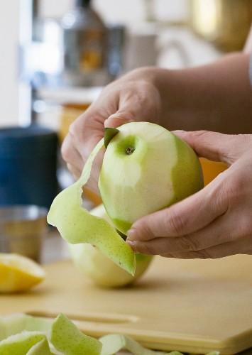 Hands Peeling a Pear
