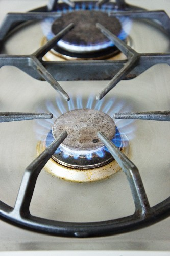 Lit gas rings on the hob (close-up)