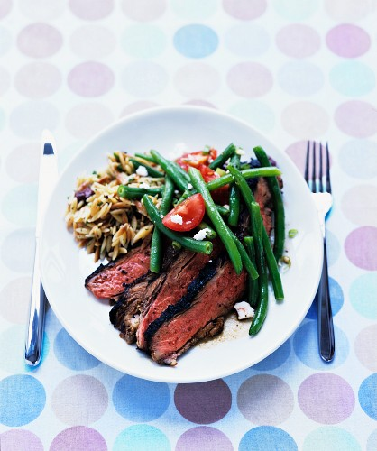 Grilled butterflied leg of lamb with green-bean feta salad and toasted orzo