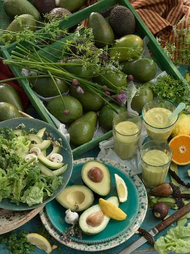 Avocado still life. Avocado, avocado smoothie, salad with avocado, lettuce, button mushroom and mange tout