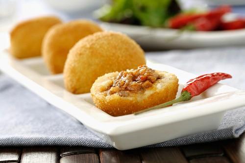 Bombas de patata y carne (fired potato dumplings filled with meat)