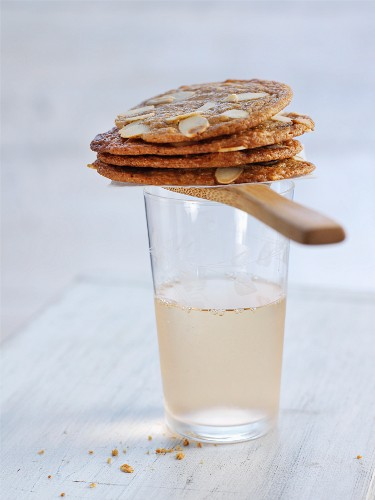 Crispy almond biscuits on top of a drink