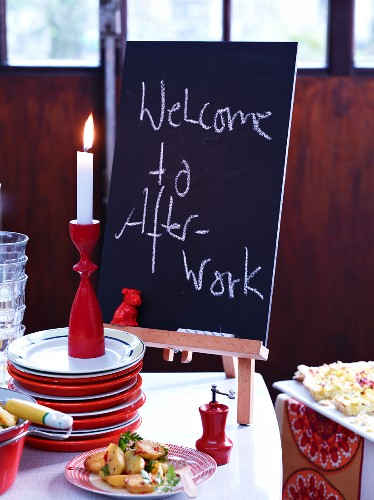 A welcome board for an after-work party on a table